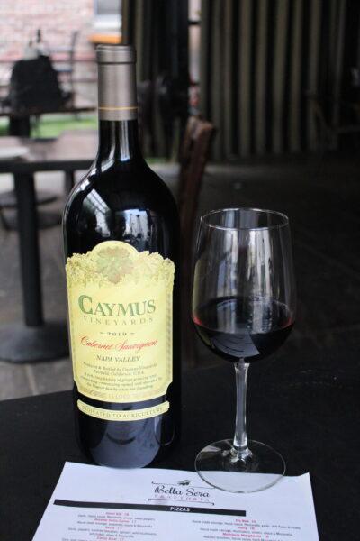 Caymus Wine bottle with Wine Glass at Bella Sera