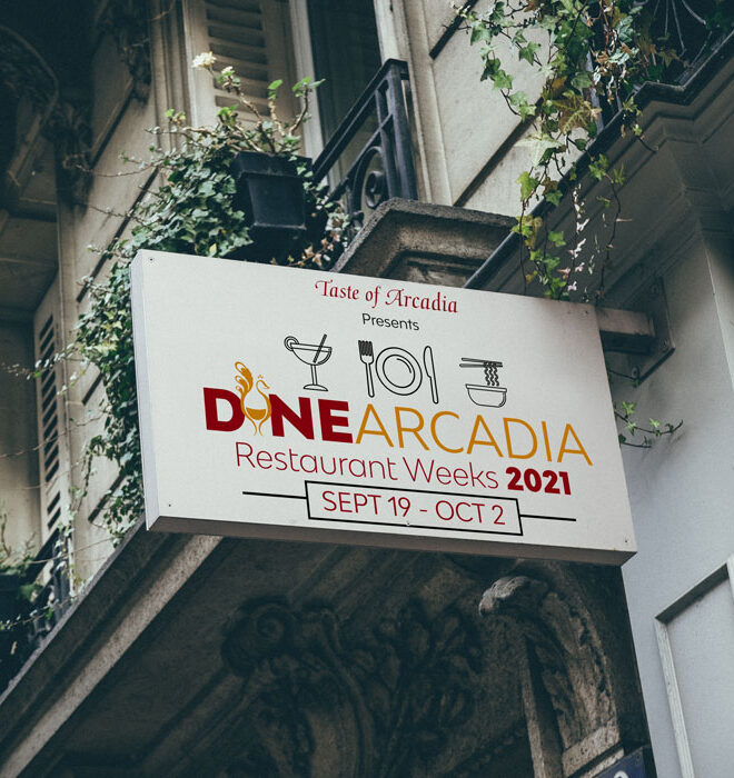 Restaurant Sign of side of building with Dine Arcadia logo as the sign