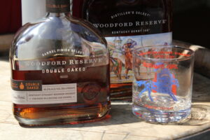Woodford Reserve whiskey bottles with whiskey glass